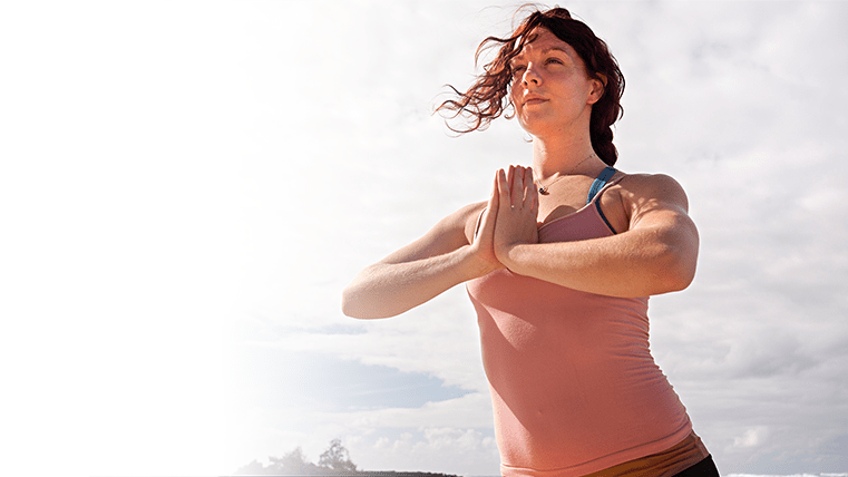 Woman in a starting yoga pose